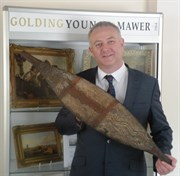 Auctioneer Colin Young With The Aboriginal Broad Shield Which Sold For £30,000