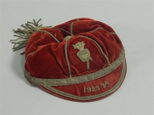 Lot 20 A red velvet and white metal sporting cap