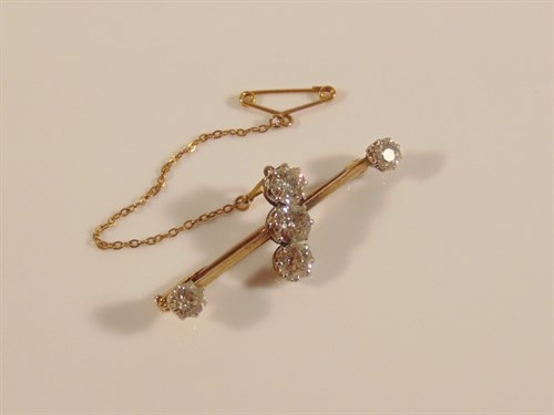 Lot 21 A five stone diamond bar brooch