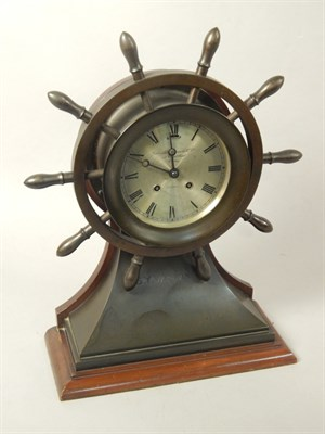 Lot 11 A Goldsmiths & Silversmiths Company ship's bell maritime clock