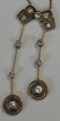 Lot 264 An Art Deco diamond necklace and chain
