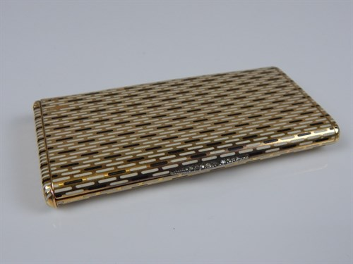 Lot 284 A French Art Deco style yellow metal combined cigarette and vesta case