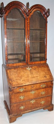 Lot 398 A Queen Anne walnut double dome top bureau bookcase