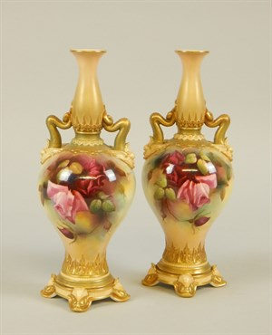 Lot4 A pair of Royal Worcester porcelain two handled vases