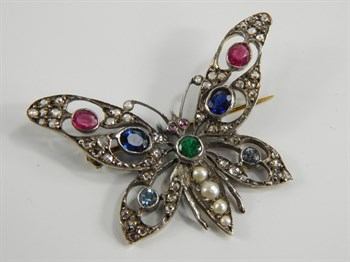 Lot 241 A yellow metal diamond and gem set butterfly brooch