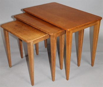 19 A nest of three Russell Of Broadway light oak finish tables
