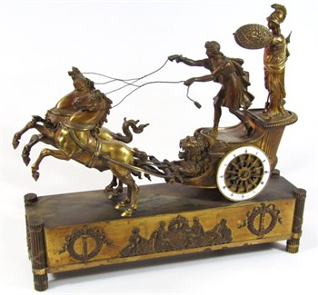 1 An early 19thC Parisian Empire ormolu mounted mantel clock