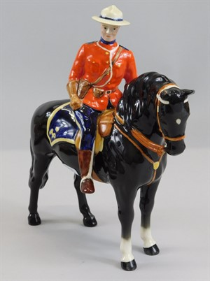 7 (2) A Beswick ceramic Canadian Mountie