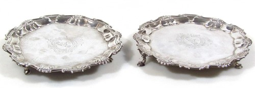 Thumbnail _lot 16 A near matching pair of George II silver waiters
