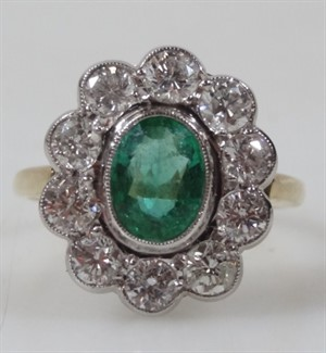Thumbnail _lot 142 An 18ct gold emerald and diamond floral cluster ring