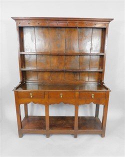 135 A Georgian oak and elm Welsh dresser