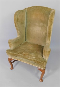 160 A Queen Anne walnut framed library wingback chair