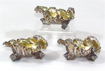 1026 A pair of William IV crested silver salts, by Paul Storr and another salt designed to match by Edward, Edward junior, John & William Barnard