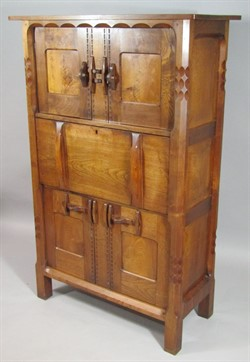 1240 An early 20thC Cotswold Gimson style Arts and Crafts oak and walnut side cabinet, probably by the workshop of Romney Green