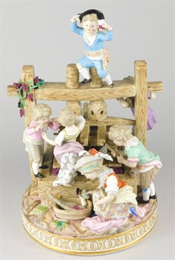 2014 A 19thC Meissen figure group, in the form of various children around a wine press