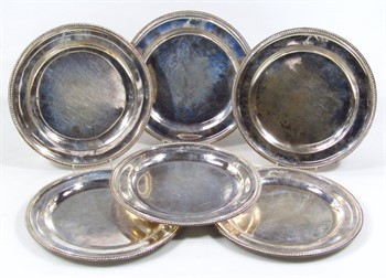lot 1101 A set of six George III silver plates, by James Young