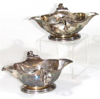 lot 1021 A Harlequin pair of George II silver sauce boats, by George Wickes and John Swift