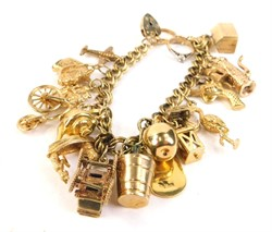 Lot 44 A 9ct gold and yellow metal charm bracelet